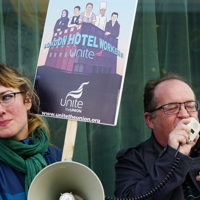 """Workers Memorial Day 2015 protest at the front of Hilton Metropole, London"" stock image"