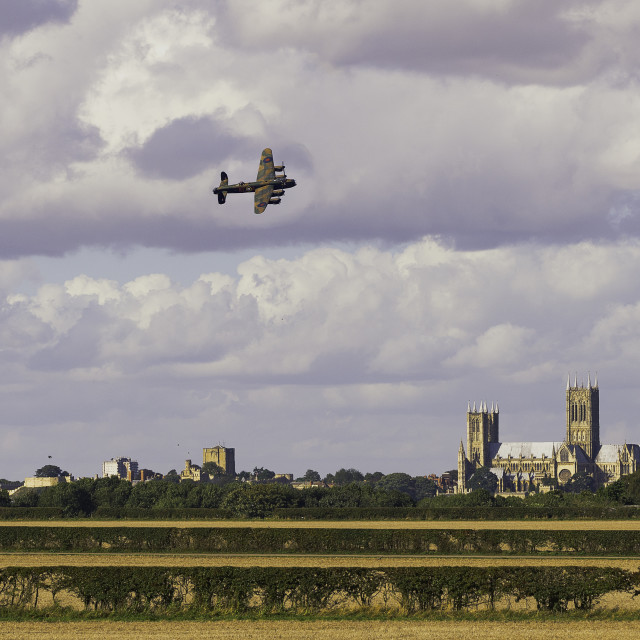 """Lancaster Bomber over Lincoln"" stock image"