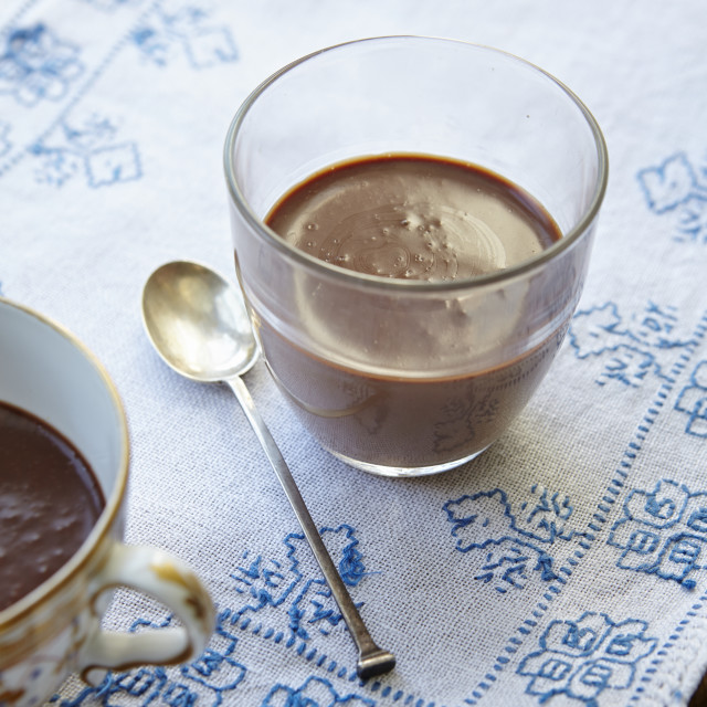 """Close-up shot of chocolate mousse in a glass on a tray."" stock image"