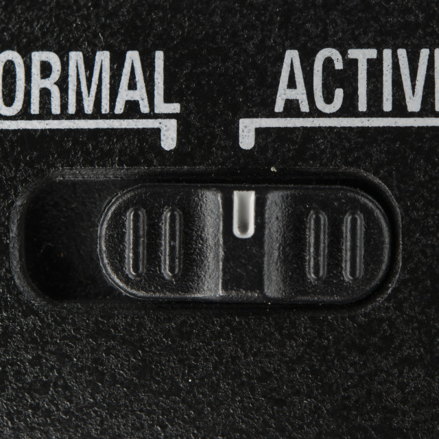 """Normal Active switch on black background"" stock image"