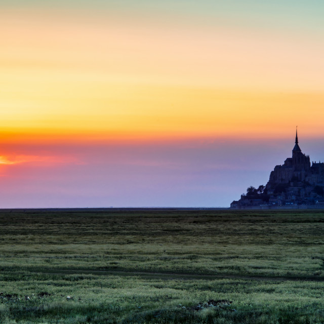 """The Glow of Le Mont Saint-Michel at Sunset."" stock image"