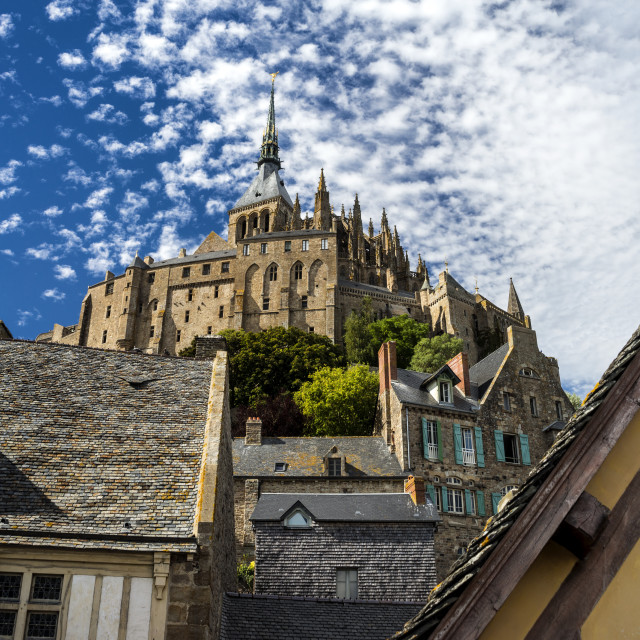 """The Abbey on Le Mont Saint-Michel through the houses."" stock image"