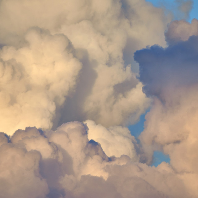 """Cumulonimbus clouds forming before a starm against a blue sky. Dramatic clouds"" stock image"