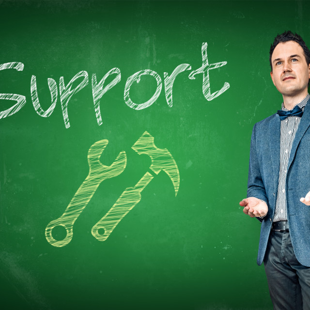 """Support employee by a chalkboard"" stock image"