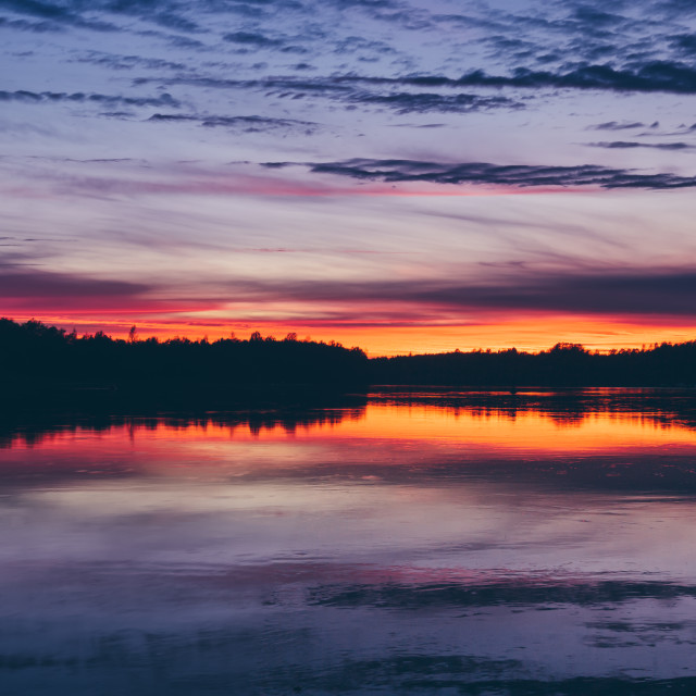 """""""Dramatic colorful big sky with clouds sunset reflection"""" stock image"""