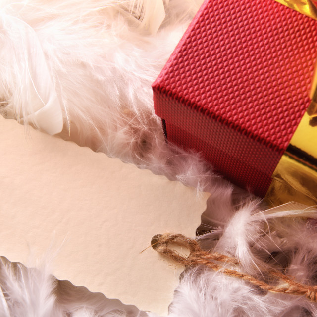 """Red gift box detail with tag on feathers top wiew"" stock image"