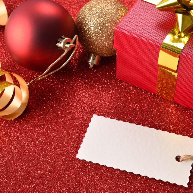 """""""Xmas decoration with tag gift balls on red table elevated"""" stock image"""