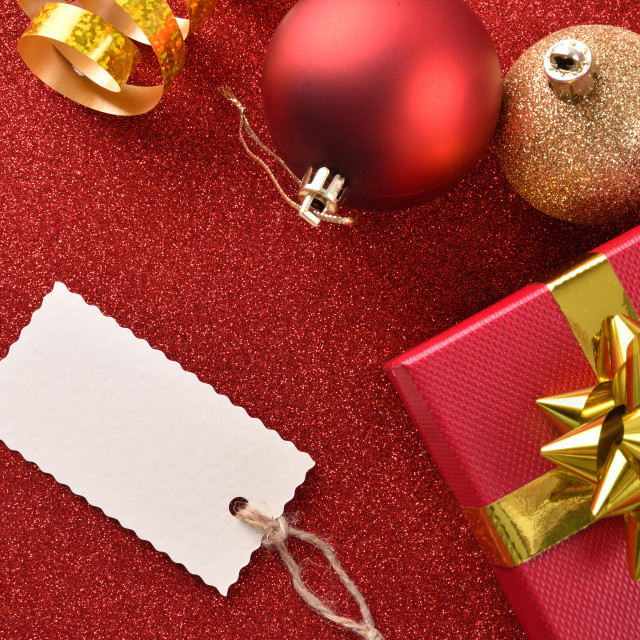 """Xmas decoration with tag gift balls on red table top"" stock image"