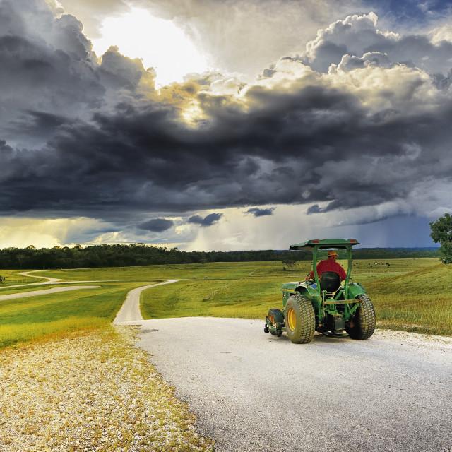 """Tractor under threatening skies"" stock image"