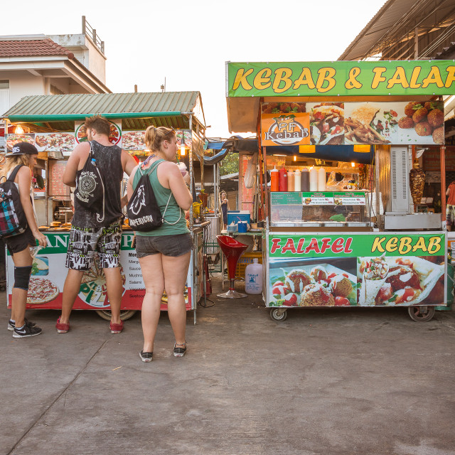 """Young people eating at thai nightmarket"" stock image"