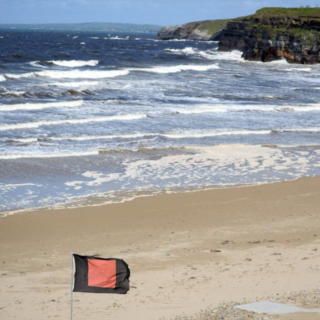 """quicksilver flag flying beside ballybunion beach"" stock image"