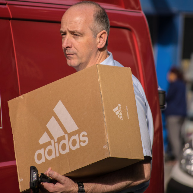 """Delivery man adidas"" stock image"