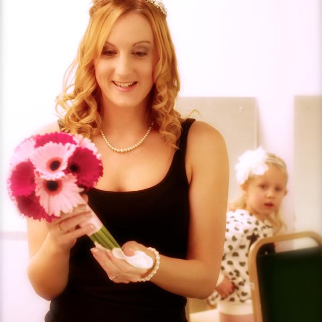 """Bride, pre preparation with young bridesmaid- high key"" stock image"