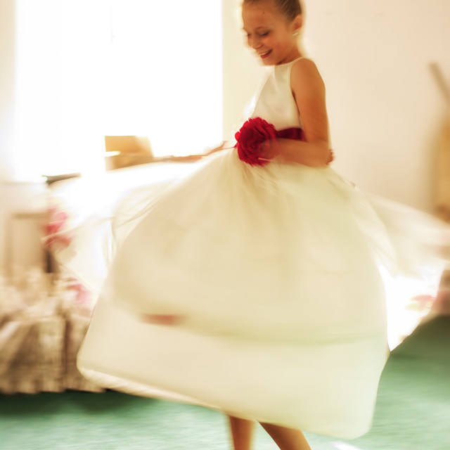 """""""Bridesmaid spinning in the light"""" stock image"""