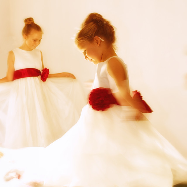 """""""Young bridesmaids, spinning in their dresses- sunny room"""" stock image"""