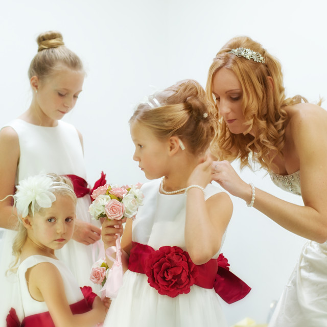 """""""Getting ready- bride helping bridesmaids to get ready"""" stock image"""