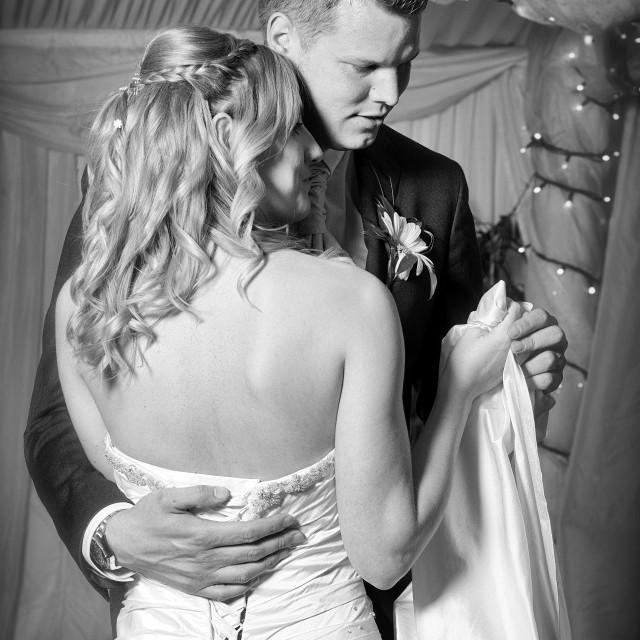 """First dance- wedding couple dancing, mono"" stock image"