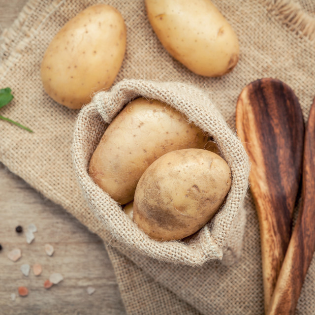 """Fresh organic potatoes in hemp sake bag with parsley ,salt and pepper on..."" stock image"