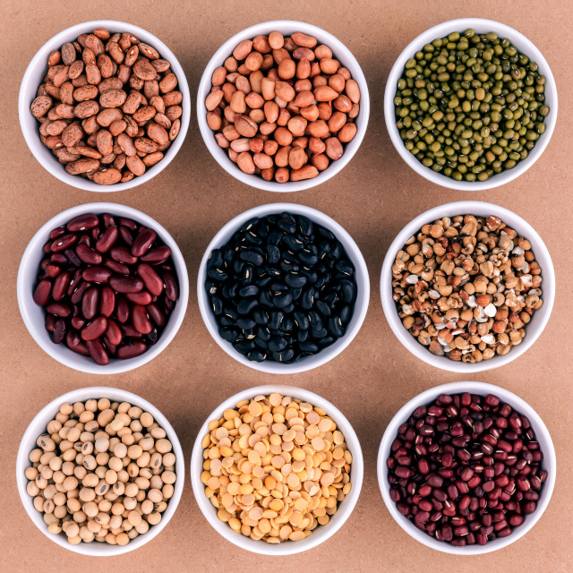 """""""Mixed beans and lentils in the white bowl on brown background. mung bean,..."""" stock image"""