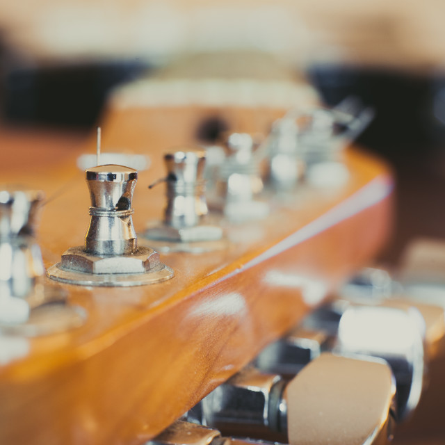 """Electric guitar headstock and chords detail, music symbol"" stock image"