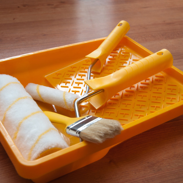 """""""Paint rollers and brush on yellow tray"""" stock image"""