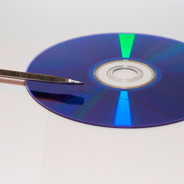 """""""data loss theme showing the surface of a scratched CD with Screwdriver"""" stock image"""