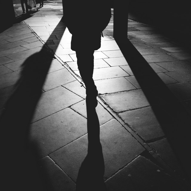 """Walking in the shadow of the street"" stock image"