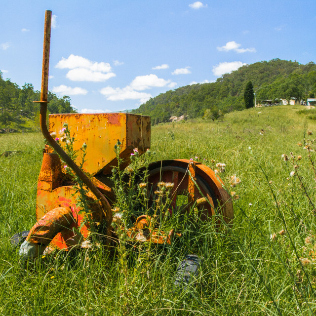 """Old Farm Machinery left in paddock - country Australia"" stock image"