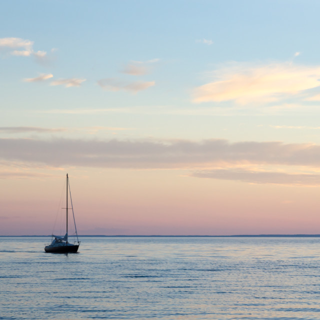 """""""Single sailboat in calm water"""" stock image"""