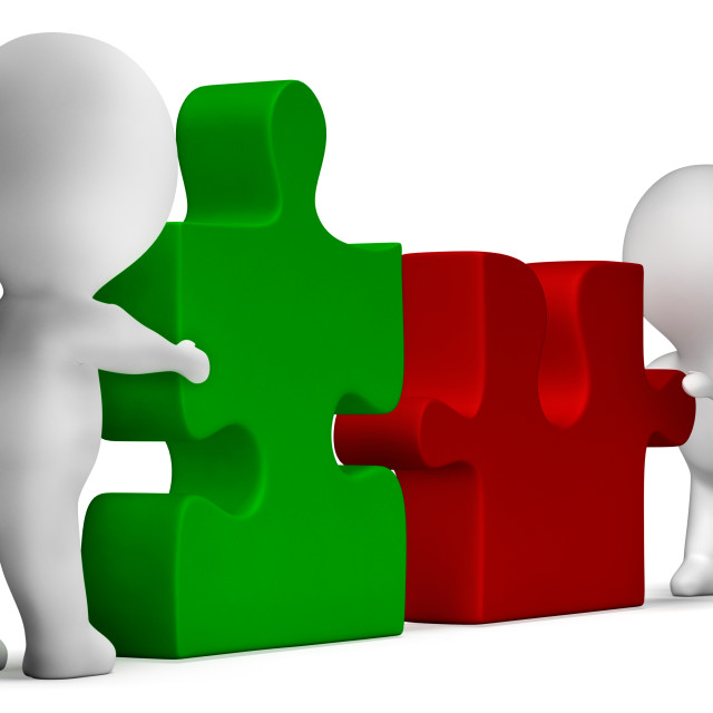 """""""Jigsaw Pieces Being Joined Showing Teamwork And Collaboration"""" stock image"""
