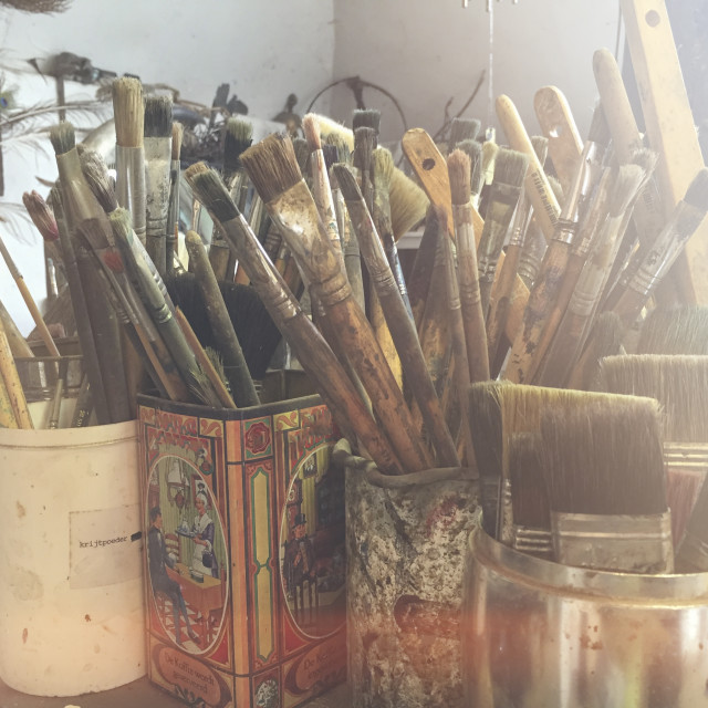 """Paintbrushes in pots"" stock image"