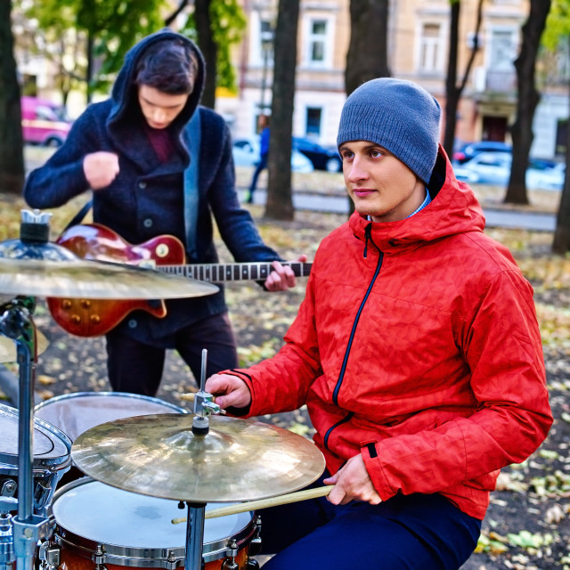 """""""Male buskers on autumn park."""" stock image"""