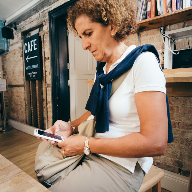 """""""Woman sitting in cafe with smartphone"""" stock image"""