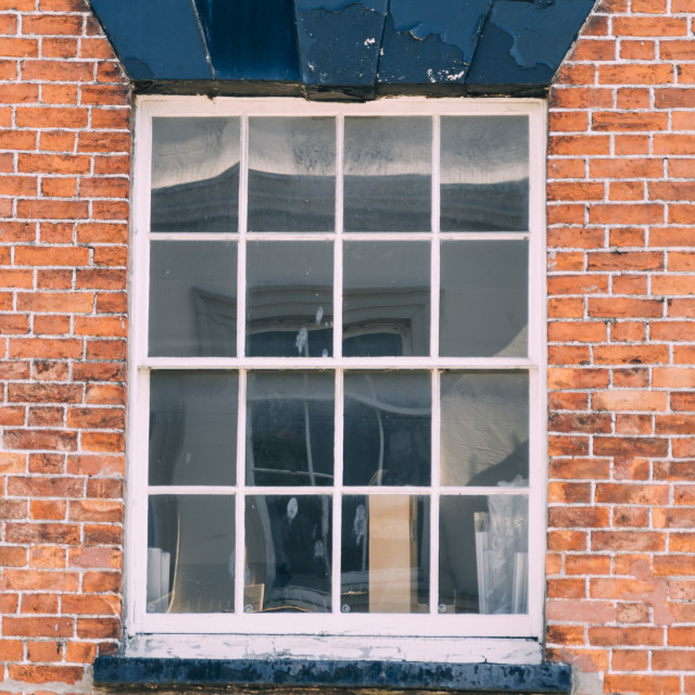 """Old window in brick wall"" stock image"