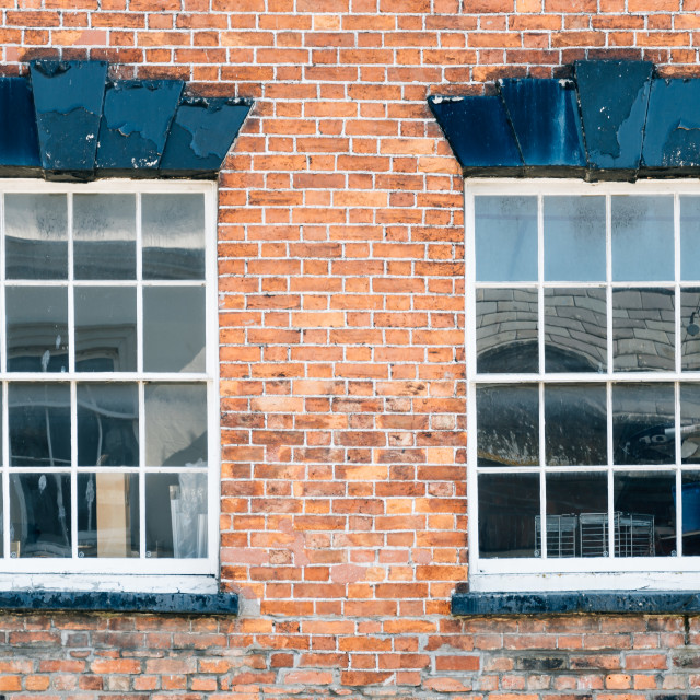 """""""Two old windows on brick wall"""" stock image"""