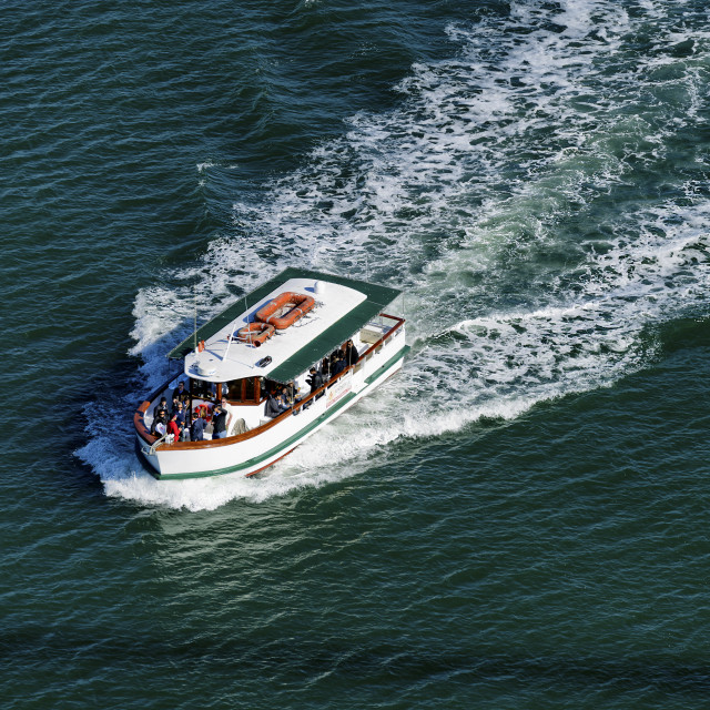 """Boat ferrying passengers"" stock image"