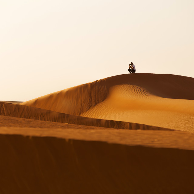 """Taking photos in the desert"" stock image"