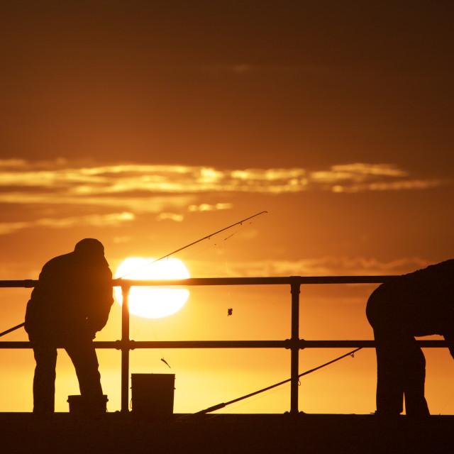 """Fishing men at the beach"" stock image"
