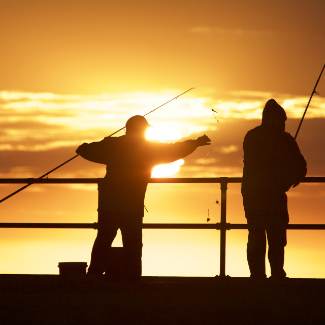"""Fishing men at the beach"" stock image"