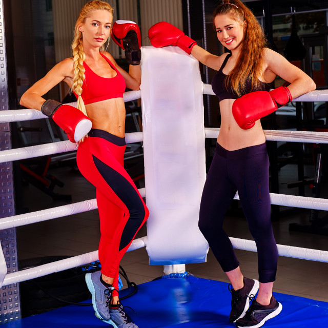 """""""Portrait of two sport girl after boxing on ring."""" stock image"""