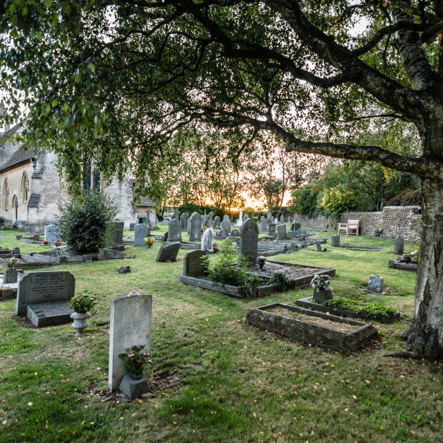 """Churchyard at sunset"" stock image"