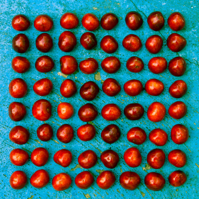 """""""Square arrangement of ripe cherries on blue textrured background"""" stock image"""