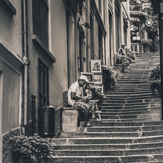 """Artist on the steps"" stock image"