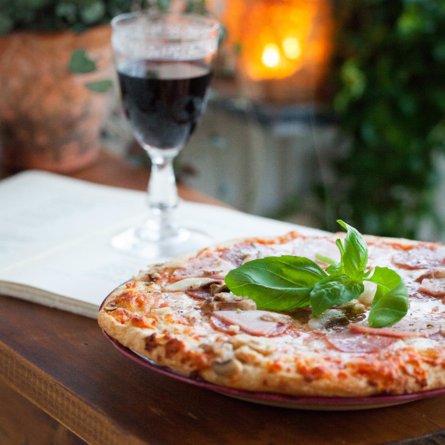 """Pizza, Wine and Poetry"" stock image"