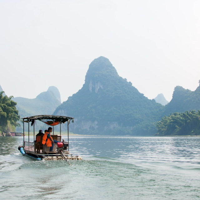 """YANGSHOU, CHINA - Tourists on a Li River Cru"" stock image"