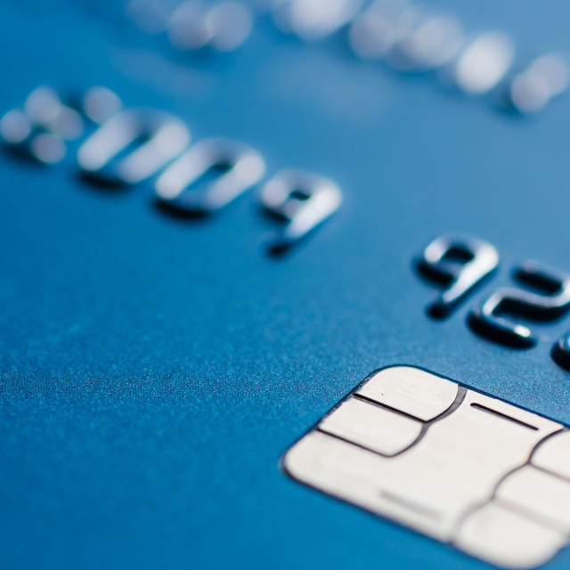 """Credit card in blue with chip close up atm emv blurred"" stock image"