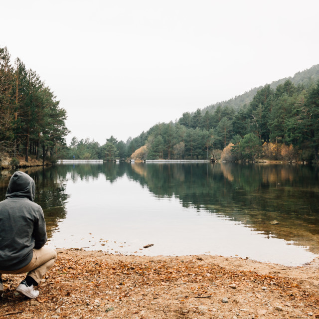 """Man looking at the lake"" stock image"