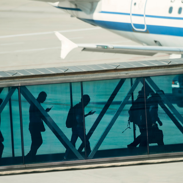 """Passengers boarding aircraft at airport"" stock image"