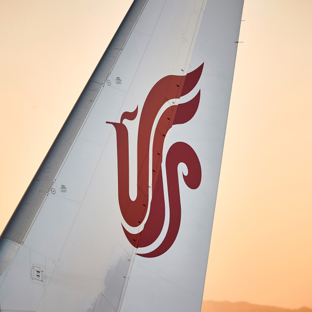 """Air China tailfin on warm summer night"" stock image"