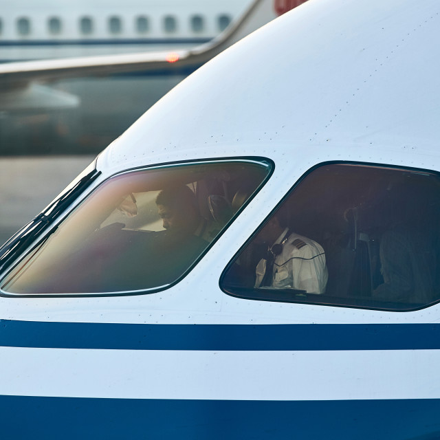 """Pilots inside Boeing 787 cockpit preparing for flight"" stock image"